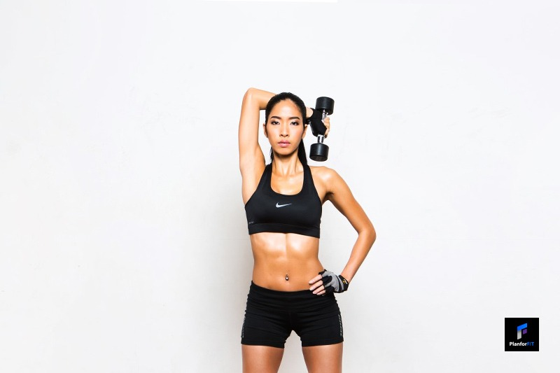 Women Dumbbell Overhead Triceps Extension Finish