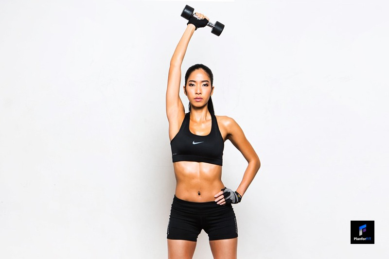 Women Dumbbell Overhead Triceps Extension Start